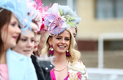 Female racegoers takes part in the Miss Cheltenham finalists line up during Ladies Day of the 2018 Cheltenham Festival at Cheltenham Racecourse. PRESS ASSOCIATION Photo. Picture date: Wednesday March 14, 2018. See PA story RACING Cheltenham. Photo credit should read: Tim Goode/PA Wire. RESTRICTIONS: Editorial Use only, commercial use is subject to prior permission from The Jockey Club/Cheltenham Racecourse.