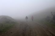 Achupallas - Sunday, Dec 30 2007: Mist shrouds two hikers near Achupallas village.  Achupallas marks the start of the Inca Trail to Ingapirca. (Photo by Peter Horrell / http://www.peterhorrell.com)