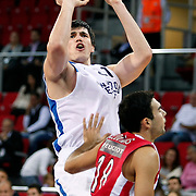 Anadolu Efes's Ersan ILYASOVA (L) during their Two Nations Cup basketball match Anadolu Efes between Olympiacos at Abdi Ipekci Arena in Istanbul Turkey on Sunday 02 October 2011. Photo by TURKPIX