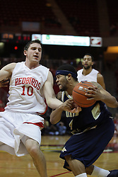 04 December 2010: Alex Rubin defends the lane as Rod Singleton charges in but Rubin gets called for a blocking foul during an NCAA basketball game between the Montana State Bobcats and the Illinois State Redbirds at Redbird Arena in Normal Illinois.