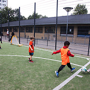 Kids from the estate and the local area play football. The local football club Nørrebro United runs football sessions in the estate for children in the area. Lundtoftegade is a housing estate in the heart of Copenhagen. The estate has been on the controversial Ghetto List for years but wastaken off 1st of December 2020. The Ghetto List is based on the Ghetto Law introduced by the Danish Govenrment in 2018. In 2020 a huge campaign was launched to raise 50.000 signatures demanding the Danish Parliament to reconsider the law and to abolish it. Part of the campaign was the national portrait poster campaign 'We ARE the mixed city'. More than 100 local residents in joined the campaign and were photographed in a small make shift studio set up in Lundtoftegade. These images are fragments of life in and around Lundtoftegade 2020.