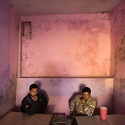 Men in a colorful restaurant. In the Himalaya.