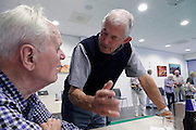 two men talking at a recreational senior indoors sport club