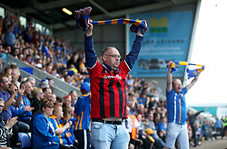 Shrewsbury Town fans raise scarves in the air to show their support during the Sky Bet League One play-off second leg match at Montgomery Waters Meadow, Shrewsbury.