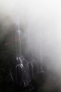 Mist shrouds a waterfall in the Bamboo Forest in southern Sichuan Province.