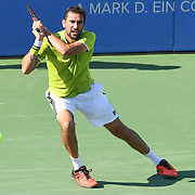 MARIN CILIC hits a backhand at the Rock Creek Tennis Center.