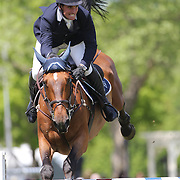 Quentin Judge riding HH Quatuor in action during the $100,000 Empire State Grand Prix presented by the Kincade Group during the Old Salem Farm Spring Horse Show, North Salem, New York,  USA. 17th May 2015. Photo Tim Clayton