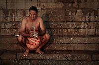 A man washing in the River Ganges during the festival of Kartik Poornima in Varanasi, Uttar Pradesh, India
