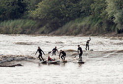 © Licensed to London News Pictures; 19/09/2020; Minsterworth, Gloucestershire, UK. Surfers ride the Severn Bore, a tidal surge on the river Severn which can reach 10m, depending on various weather factors and tide and river levels. Surfers and canoeists can travel miles up river on the bore. Photo credit: Simon Chapman/LNP.