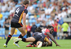 Aderito Esteves of Portugal is challenged by Carol Soteras Merz of Germany - Photo mandatory by-line: Dougie Allward/JMP - Mobile: 07966 386802 - 11/07/2015 - SPORT - Rugby - Exeter - Sandy Park - European Grand Prix 7s