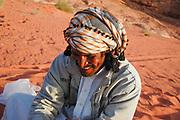 A Syrian camel driver named Ibraham in the Jordanian desert of Wadi Rum