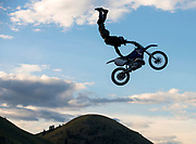 Josh Headford executes a Superman seat grab during the Sick Air Show on Wednesday before the monster truck show at Teton County Fair.