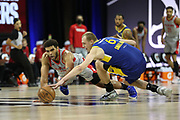 ORLANDO, FL - MARCH 8: Anthony Lamb #34 of the Rio Grande Valley Vipers and Alen Smailagic #6 of the Santa Cruz Warriors dives for the loose ball during the NBA G League Playoffs on March 8, 2021 at HP Field House in Orlando, Florida. NOTE TO USER: User expressly acknowledges and agrees that, by downloading and/or using this Photograph, user is consenting to the terms and conditions of the Getty Images License Agreement. Mandatory Copyright Notice: Copyright 2021 NBAE (Photo by Chris Marion/NBAE via Getty Images)