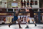 UFC middleweight Derek Brunson of North Carolina spars with UFC welterweight Kyle Noke of Australia at Jackson Wink MMA in Albuquerque, New Mexico on June 9, 2016.