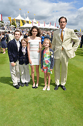 Left to right, GEORGE COLLINGS, ARCHIE COLLINGS, FELICITY COLLINGS, CATY COLLINGS and their father BEN COLLINGS husband of Lady Louisa Collings at the Qatar Goodwood Festival - Ladies Day held at Goodwood Racecourse, West Sussex on 30th July 2015.