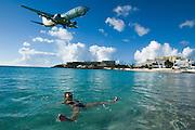Maho Beach. BWIA Boeing 737 landing at Juliana Airport. Nicole Schmidt having a swim.