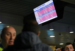 A departures information board at London City Airport which has reopened after dozens of passengers were treated for breathing difficulties after a suspected chemical incident at the airport.