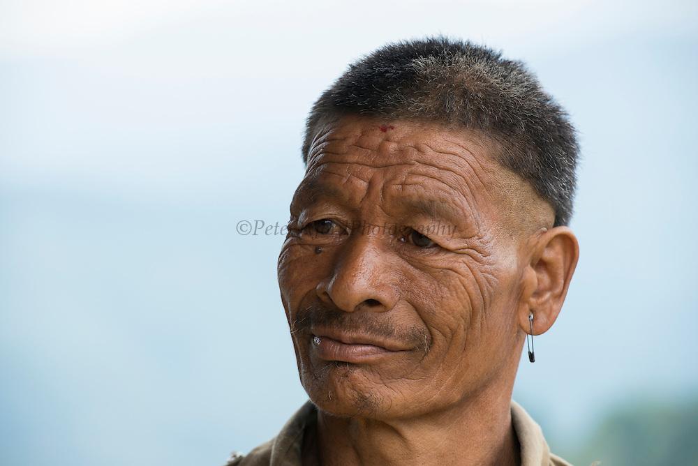 Chang Naga man with traditional haircut<br /> Chang Naga headhunting Tribe<br /> Tuensang district<br /> Nagaland,  ne India