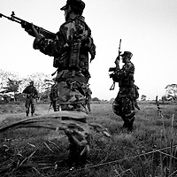 Government soldiers on manoeuvres in the heavily disputed region of Aruaca. The area is rich in oil and large amounts of coca are grown in the firtile soil. Two rebel groups; the FARC and ELN are fighting AUC paramilitaries for domination of the zone.<br />