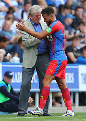 Crystal Palace's Andros Townsend is substituted and shakes hands with Crystal Palace Manager Roy Hodgson during the pre-season friendly match at the Madejski Stadium, Reading.