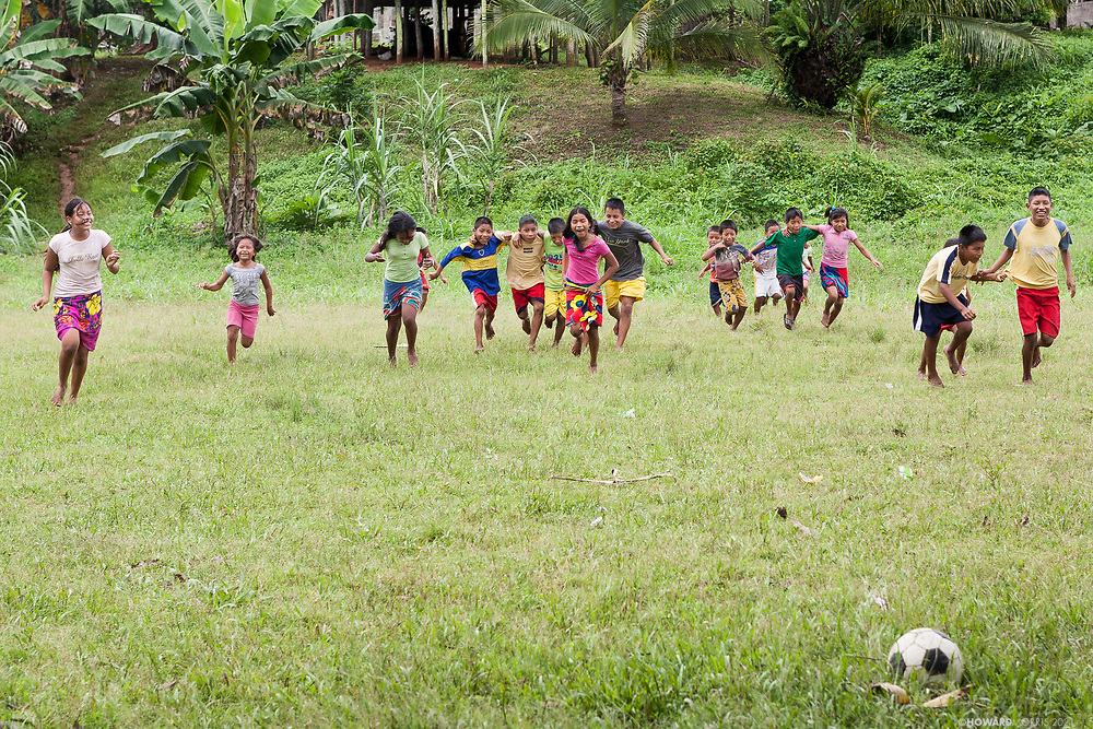 Embera school children enjoying the government built soccer field. Villa Keresia, Panama.