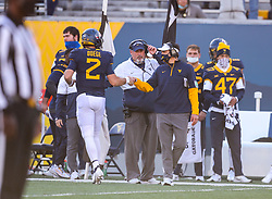 Nov 14, 2020; Morgantown, West Virginia, USA; West Virginia Mountaineers quarterback Jarret Doege (2) celebrates with West Virginia Mountaineers head coach Neal Brown after throwing a touchdown during the fourth quarter against the TCU Horned Frogs at Mountaineer Field at Milan Puskar Stadium. Mandatory Credit: Ben Queen-USA TODAY Sports