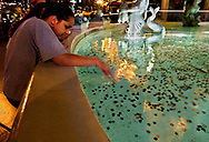 A foreign visitor to the Paris Hotel and Casino in Las Vegas has dreams of riches as she dabbles her hand in a fountain full of coins.  Las Vegas, with it's water problems, is gambling as well that water in the region will always be available as growth continues to apply pressure to an already depleted Lake Mead.  Wednesday, April 21, 2004.