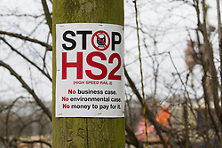 Wendover, UK. 18th March, 2021. A Stop HS2 sign is pictured close to tree felling and hedge clearance work for the HS2 high-speed rail link. Considerable preparatory work of this type is currently taking place along a section of the route between Great Missenden and Wendover which lies to the north of the Chiltern tunnel section of the £106bn rail link.