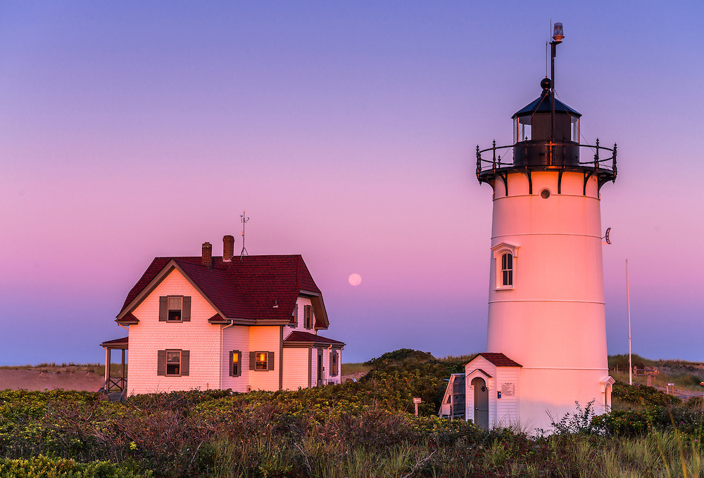 Race Point Light in pink dawn light with setting moon, Cape Cod National Seashore, Provincetown, MA