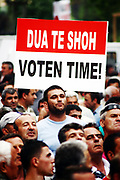 """Albanian opposition supporters hold banners during a demonstration, in Tirana, Albania, Wednesday, May 5th, 2010. Tens of thousands of opposition supporters thronged the main square of the Albanian capital Wednesday, vowing to stay there until the government allows a partial recount of June election ballots following allegations of vote-rigging. Thousands of red and black Albanian socialists march every evening day to gather together in """"National martyrs"""" boulevard at 18:00 cheered and applauded the speeches of various socialist deputies, in the place where the strikers are located. Speeches of representatives of Albanian political socialists daily and more are made even more harsh, red and black Albanian daily and more are inspired to be willing to answer any call that their socialist leaders will call to act to make protection on behalf of their free votes, transparency and guarantee the development of democracy in the country. <br /> (Vedat Xhymshiti / ZUMA Press)"""