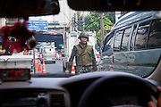 18 MAY 2010 - BANGKOK, THAILAND:  A Thai soldier at a roadblock on Sukhumvit Road in Bangkok. This is the closest point to the Red Shirt camp in Ratchaprasong Intersection and people are not allowed past it. Violent unrest continued in Bangkok again Tuesday nearly a week after Thai troops started firing on protesters and Bangkok residents took to the streets in violent protest against the government. Tuesday was not as violent as previous days however. Although protesters continued to set up roadblocks and flaming tire barricades across parts of the city, there was not as much gunfire from the government lines. The most active protesters were at the Din Daeng Intersection about a mile from the Red Shirts' Ratchaprasong camp.  PHOTO BY JACK KURTZ