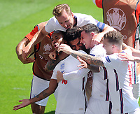 Football - 2021 EUFA European Championships - Finals - Group D - England vs Croatia, Wembley Stadium<br /> <br /> Raheem Sterling of England celebrates his goal with team mates<br /> <br /> Credit : COLORSPORT/Andrew Cowie