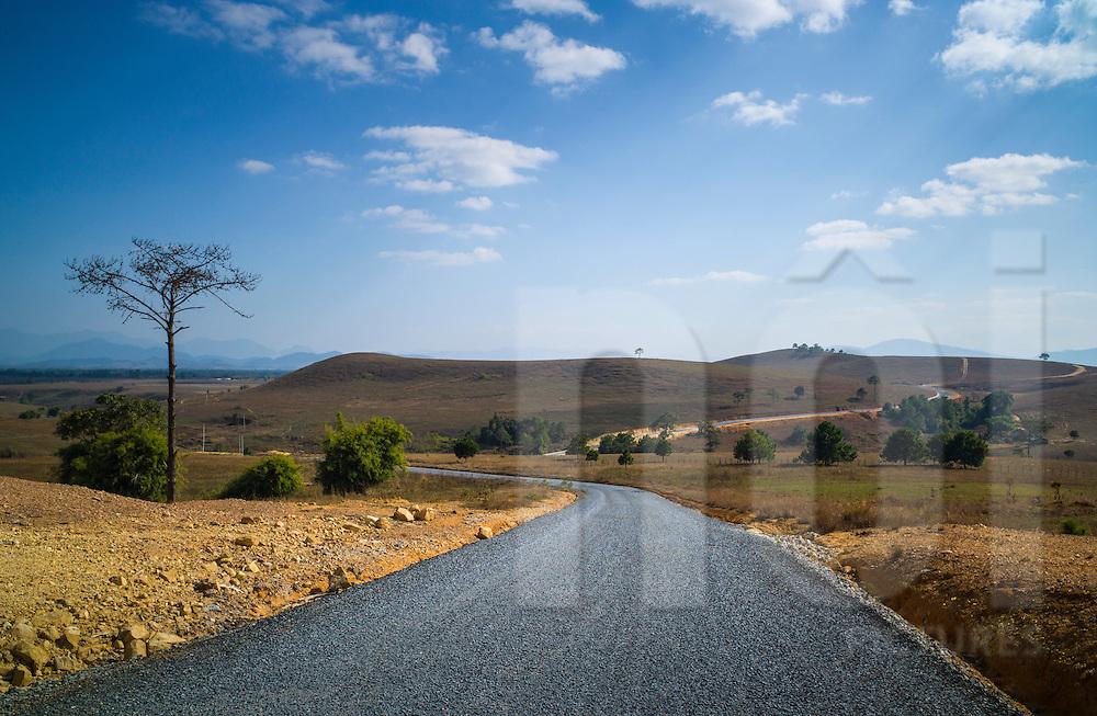 Windy road leading to the Plain of Jars - Phu Keng Jars Quarry Site, West of Phonsavan, Xieng Khouang Province, Laos, Southeast Asia