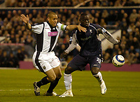 Photo: Glyn Thomas.<br />West Bromwich Albion v Bolton Wanderers. The Barclays Premiership. 17/04/2006.<br /> West Brom's Nigel Quashie (L) and Bolton's Abadoulaye Faye.