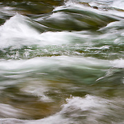 Rapids during spring run off along the banks of the Sol Duc River in Olympic National Park, Washington.