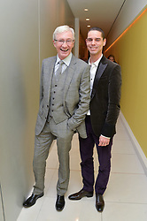 Left to right, PAUL O'GRADY and ANDRE PORTASIO at a pre party for the English National Ballet's Christmas performance of The Nutcracker was held at the St.Martin's Lane Hotel, St.Martin's Lane, London on 12th December 2013.
