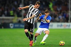 Genoa (Italy): Italian Championship match Sampdoria vs Juventus. 19 Nov 2017 Pictured: Mario Mandzukic of Juventus FC and Bartosz Bereszynski of UC Sampdoria fight for the ball during the Italian Championship match UC Sampdoria vs Juventus FC player at Luigi Ferraris Stadium in Genoa, on November 19, 2017. Photo credit: Massimo Cebrelli / MEGA TheMegaAgency.com +1 888 505 6342