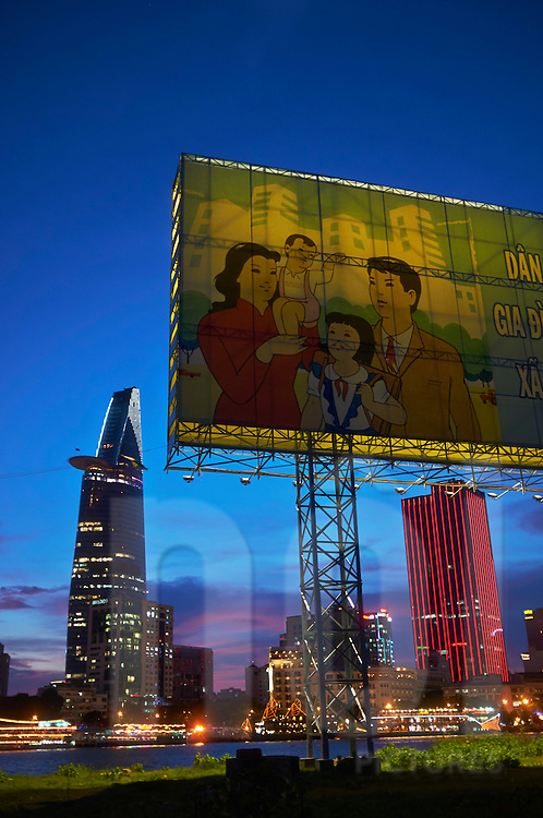 Propaganda billboard at night along Saigon River with Bitexco Tower in background, Ho Chi Minh City, Vietnam, Southeast Asia