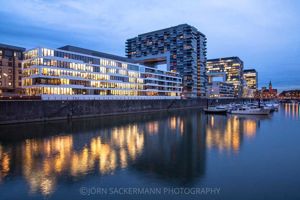the building Dock 6-10 and the Crane Houses in the Rheinau harbour, in the background the old harbour masters office, Cologne, Germany.<br /> <br /> das Buerogebaeude Dock 6-10  und die Kranhaeuser im Rheinauhafen, im Hintergrund das alte Hafenamt, Koeln, Deutschland.