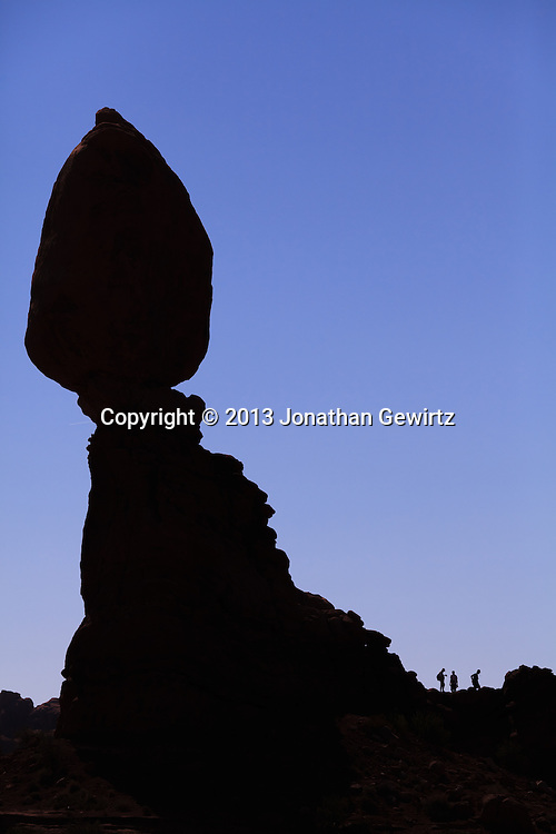 Balanced Rock and visitors to Arches National Park, Utah. WATERMARKS WILL NOT APPEAR ON PRINTS OR LICENSED IMAGES.<br /> <br /> Licensing: https://tandemstock.com/assets/16600633