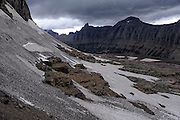 The remaining snowfield at the base of Mount Clements at Logan Pass, Glacier National Park, Montana, Tuesday, October 7, 2014. According to Dan Fagre Ph.D. of the USGS this is the location of a glacier from the little ice age that ended in 1850 and probably disappeared in the 1940's. In the distance is the Garden Wall.