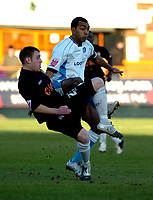 Photo: Ian Hebden.<br /> <br /> Barnet FC v Wycombe Wanderers. Coca Cola League 2. 21/01/2006.<br /> <br /> Barnets Barry Fuller (L) and Wycombes Kevin Betsy (R) clash for the ball.