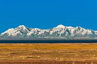 Bolivian mountains from peruvian Andes Titicaca Lake at Puno Peru