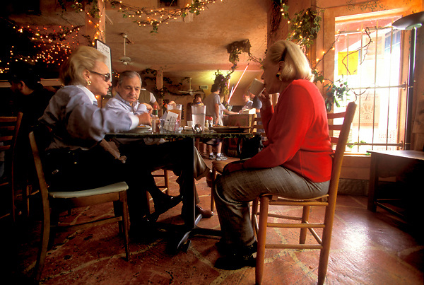Stock photo of diners enjoying the atmosphere and good company at one of Houston's many restaurants.