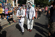 Dead outfits at Notting Hill Carnival on 25th August 2019 in West London, United Kingdom. A celebration of West Indian / Caribbean culture and Europes largest street party, festival and parade. Revellers come in their hundreds of thousands to have fun, dance, drink and let go in the brilliant atmosphere. It is led by members of the West Indian / Caribbean community, particularly the Trinidadian and Tobagonian British population, many of whom have lived in the area since the 1950s. The carnival has attracted up to 2 million people in the past and centres around a parade of floats, dancers and sound systems.