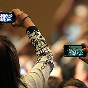 Attendees take photos of President Barack Obama as he departs after his speech at the NALEO (National Association of Latino Elected and Appointed Officials) conference at the Disney Contemporary Resort Convention Center in Lake Buena Vista, Fla. on Friday, June 22, 2012. (AP Photo/Alex Menendez) President Barack Obama speaks in Orlando, Florida.