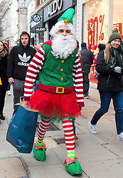 © Licensed to London News Pictures. 15/12/2018. London, UK.  A man dressed as an elf Christmas shopping in Oxford Street in London today, less than two weeks before Christmas on what is usually one of the busiest shopping weekends of the year.  Photo credit: Vickie Flores/LNP