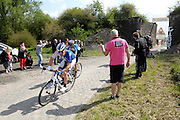 France, April 13th 2014: The first riders come through Pont Gibus, Wallers, during the Paris Roubaix 2014 cycle race.