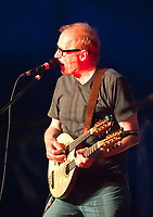 Adrian (Ade) Edmondson - English comedian, actor, writer, musician, television presenter- sings and plays with his band The Bad Shepherds at the 2014 Dinefwr Literature Festival. Llandeilo, Carmarthenshire