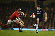Huw Jones of Scotland ® breaks away from Ken Owens of Wales. Wales v Scotland, NatWest 6 nations 2018 championship match at the Principality Stadium in Cardiff , South Wales on Saturday 3rd February 2018.<br /> pic by Andrew Orchard, Andrew Orchard sports photography